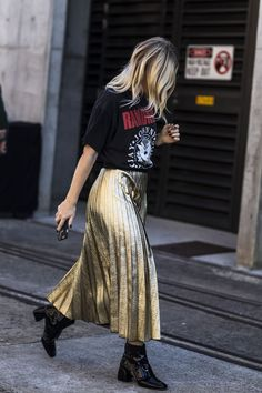 See All The Best Street Style From Fashion Week Down Under #refinery29  http://www.refinery29.com/2016/05/111596/sydney-fashion-week-resort-2016-street-style-pictures#slide-29  Dress down a gold pleated skirt with a simple band tee and block heel booties....