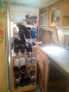 I bought a plastic shoe organizer to hang on the back of our bathroom door. It's a great organizer to use due to lack of space in our cramped quarters. Love it!