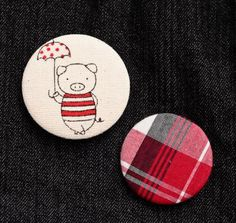 buttons, pig and tartan. ultimate must.