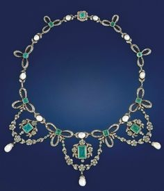 A late 19th century pearl, emerald and diamond tiara/necklace  The front with triple swags of flowerhead clusters and single pearl drop, each suspending a central rectangular-cut emerald to flowerhead surmount, the graduated neckchain comprising rose-cut diamond bows with central square-cut emerald and pearl spacers, circa 1890, with tiara frame