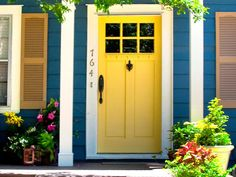 Set against blue siding and white molding, this vibrant yellow door sets a cheerful tone.