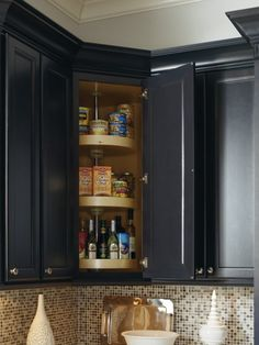 Make the most of corner space with a lazy susan and bring the back of the cabinet to you. By Thomasville Cabinetry.