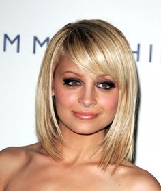 Love the length/style...not sure if I would do bangs or not though.