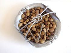 Hey, I found this really awesome Etsy listing at https://www.etsy.com/listing/172185972/vintage-aluminum-basket-nut-dish-candy