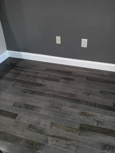 Show off your style with a gorgeous gray that lets your personal style shine! Grey Wood Floors, Grey Flooring, Grey Walls, Interior Design Living Room, Living Room Designs, Living Room Decor, Home Remodeling, House Plans, New Homes