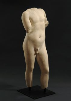 Important Roman marble statue of a young boy