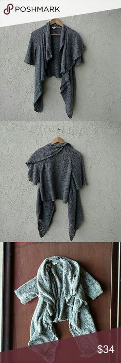 Soft and Cozy Gray Leifsfottir Ruffled Cardigan Wrap yourself in gorgeousness.  Ruffled, super soft asymmetric gray cardigan from Anthropologie.  Short sleeves. Lower length in the back, this stunner cascades in longer ruffles at the front.  Lacy pattern knit. Scalloped edges.  44? nylon / 42% wool / 14% alpaca.  Pristine condition.  A lovely, feminine sweater that is sooooooo soft and beautifully constructed.  Size small, but easily fits a medium. Anthropologie Sweaters Cardigans