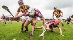 Holding the opponents stick as he does a quick roll lift. Kilkenny's Kevin Kelly and TJ Reid with Gearoid McInerney and Fergal Moore of Galway Quick Rolls, Rugby, Coaching, Hold On, Cricket, Irish, Golf, Sport, Memes