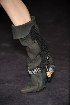 Isabel Marant Spring 2010 slouchy camouflage boots.