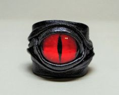 These Adjustable Leather Dragon Eye Rings are the ideal statement rings for anyone who loves quirky jewelry pieces as it is impossible to miss.