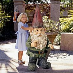 A massive 4 foot tall garden gnome that is intricately cast from high quality designer stone resin and then hand-painted for extra whimsically magical realism.
