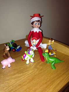 Day 9, 2013 - Sprinkle is playing with the toy story guys since we are having a Jessie the cowgirl birthday party tomorrow - Elf on the Shelf Idea - Preschool Christmas Activity