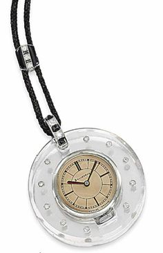 AN ART DECO DIAMOND-SET PENDANT WATCH, BY BOUCHERON  The circular dial with black painted baton hour markers and plain hands, to the bevelled rock crystal case with brilliant-cut diamond collet detailing, suspended from a sugar-loaf onyx and diamond-set pendant loop, black silk cord and similarly-set toggle, mechanical movement signed Mido beneath glazed cover visible to the reverse, circa 1930, case 4.3cm wide  Signed Boucheron to the dial