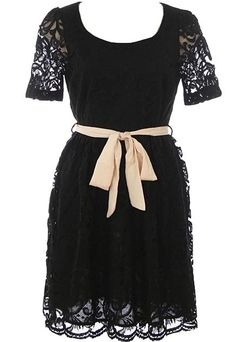 Prim Lace Dress: Features a clean scoop neckline framed by short and sheer lace sleeves, beautiful embroidered lace shell with tonal liner for full coverage, removable contrast ribbon belt at waist, and a sugary sweet scalloped hem to finish.