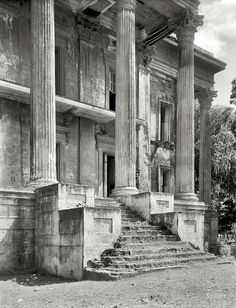 discutant: Old South Gothic: Decaying portico of the Belle Grove mansion, Louisiana, photographed in 1938. Belle Grove, built in 1857 and abandoned in the 1920s, composed 75 rooms and was reputedly the largest plantation house in the South. Photo by Frances Benjamin Johnston, via Shorpy.