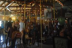 Story City children ride the town's antique carousel during Scandinavian Days on Saturday. The Story City tradition is celebrating 50 years this weekend. Photo by Julie Ferrell/Ames Tribune   http://amestrib.com/news/story-city-celebrates-50-years-scandinavian-days