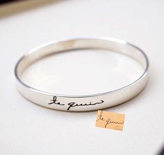 A simple piece that says a lot is this personalized handwriting bracelet from AshleeArtis. This silver bangle bracelet lets you add a personal message for your bridesmaid.