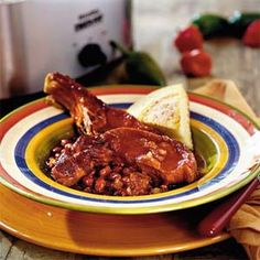 Our Best Pork Slow-Cooker Recipes  | Spicy-Sweet Ribs and Beans | MyRecipes.com