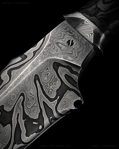 "2 of 5 Maker: Sam Lurquin, JS Website: samuel-lurquin.com Blade Length: 9 3/4"" Overall Length: 26 1/2"" Damascus: 28.42 (O2) & 27.21 (L6) Carving: Serge Raoux From Sam: ""Braiding leather was directed by Stéphane Auberthié, a specialist in Japanese art and design and the rest was done by me."""