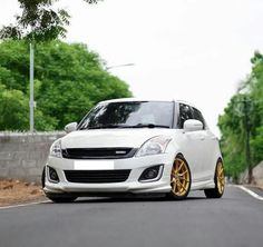 Custom Maruti Swift with gold alloy rims - In Images Royal Enfield Wallpapers, Bullet Bike Royal Enfield, Suzuki Swift Sport, Blur Background Photography, Suzuki Cars, Wide Body Kits, Car Backgrounds, Car Interior Accessories, Best Background Images
