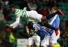 Celtic's Victor Wanyama falls to the ground after challenging St Johnstone's Greg Tade for the ball during their Scottish League Cup soccer match at Celtic Park stadium in Glasgow.