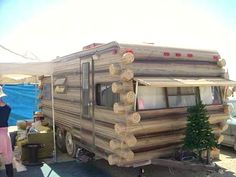 Guess they couldn't decide if they wanted a log cabin or a travel trailer!  Love the Christmas tree in front!