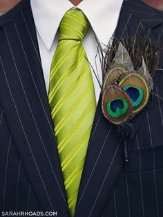 T boutounniere: Peacock feather boutonniere