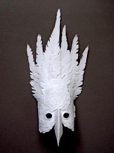 An elaborate paper mask by Atlanta-based The Paper Cut Project as featured on LuxeCrush.com