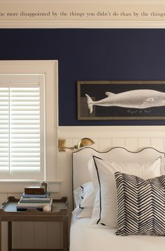 Wave Headboard + brass sconce + beadboard +Edgartown Side Table +navy paint + double crown molding with quote.  Like the whale picture and plantation shutters too, ohand the bedding!