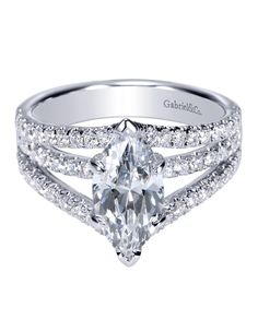 This beautiful Gabriel Bridal 14k White Gold Contemporary Split Shank Engagement Ring brings all your attention right to the marquise center stone.
