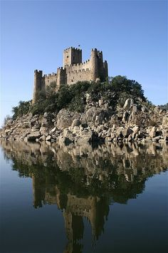 Castelo de Almourol is a medieval castle, located on a small islet in the middle of the Tagus River, in the civil parish of Praia do Ribatejo, in the Portuguese Centre Region. The castle was part of the defensive line controlled by the Knights Templar, and a stronghold used during the Portuguese Reconquista.