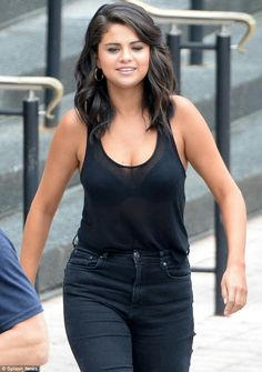 Body confident: Selena Gomez was spotted out and about in New Orleans, Louisiana sporting a semi-sheer tank top showing ample cleavage with her black bra on Monday