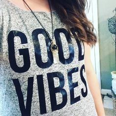 """Heather Gray & Black """"Good Vibes"""" Scoop Neck Shirt Grey short sleeve top saying """"GOOD VIBES"""" in a size Large. Brand new and in perfect condition, true to size, and super cozy!!! Measurements take flat are 20"""" Bust and 29"""" from shoulder to hem. I'm 5'4"""" 180lbs modeling it for reference. Please ask if you have any questions. Bundle and Save Free Kisses Tops Tees - Short Sleeve"""