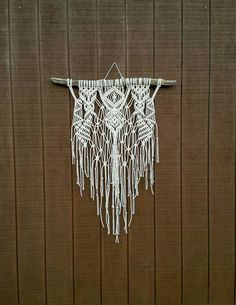 This is a LARGE piece! This macrame piece was handmade by me using 100% natural cotton rope and driftwood. Could be used as a wedding backdrop, wall hanging, headboard, or whatever you like! This piece is bigger than it looks! Macrame measures approx 4 from the top of the driftwood to the bottom of fringe. Hangs from a 35 wide piece of driftwood. Please read shop policies before purchasing and feel free to contact me with any questions!! If your country is not listed in the shipping…