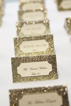 Gold glitter escort cards. I'd like to see the inset card have the flourish cut-out to tie in with the invitation card.