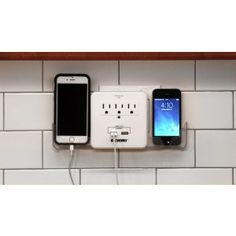 Transform a standard outlet into a dock for up to five devices! Space-saving Smartphone Charging Station has two USB ports, plus three grounded outlets for other devices or appliances. Two side slide-in cradles hold phones safely off surfaces; built-in holders keep cords neat.   $20