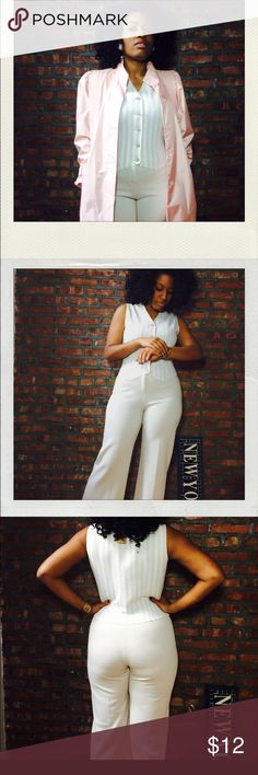 Cream and white jumpsuit with pin-stripe detail Take me to church in this well-made vintage jumpsuit. Tapered at the bottom to highlight your statement red or black pump. This piece is also in perfect shape. Great for a girl with curves. Jo hardin Other