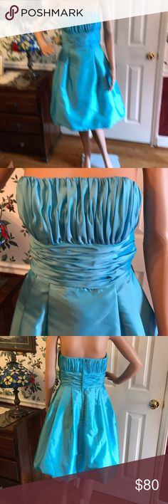 "Mori LEE by MADELINE GARDNER This baby Blue formal dress is a ""Baby Doll"". Featuring a Sweetheart Strapless gathered bust along with a gathered waistline. Short length front to bottom is 34"". This dress is NWOT. Excellent Condition No Flaws. Size is 9/10 Dresses"