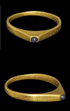 Medieval Gold Bishop's Stirrup Ring with Amethyst    14th century AD . A large finger ring with flat-section hoop expanding to deep shoulders and pyramidal bezel with inset large amethyst cabochon.
