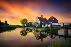 https://flic.kr/p/ugNcGr   Typical Dutch!   Zaanse Schans, The Netherlands.  This was taken last week right after sunset. Zaanse Schans is a famous windmill village in the Netherlands that attracts many tourists. This spot has been photographed countless