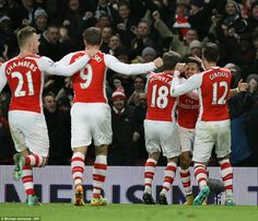 Arsenal players celebrate Alexis Sanchez's (second right) dramatic late goal in their 1-0 ...