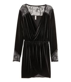 Black. Short dress in soft velour with a sheen. Wrapover front section, lace yoke, elasticized seam at waist, and long sleeves with lace at cuffs.