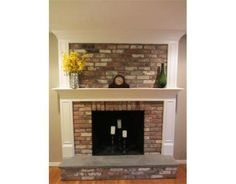 brick fireplace trimmed out, I would love to do the mantle of my fireplace like this, but leave the above brick exposed. Fireplace Trim, Brick Fireplace Makeover, Fireplace Remodel, Fireplace Design, Renovate Fireplace, Brick Fireplaces, Barbecue, Living Room Inspiration, House Painting
