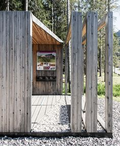 a series of timber frames playing with solid and void forms a multi-functional structure serving as a lookout point, info center, and bus stop.