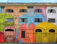 This is a part of the Italian street artist Blu's giant new mural that wraps around two sides of a building in Rome. He has turned 48 windows into mouths and eyes of some 27 bizarre faces. See more at http://blublu.org/sito/blog/