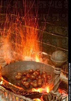 Chestnuts roasting on an open fire...MY DAD WOULD PREPARE THE CHESTNUTS WITH SO MUCH PATIENCE..IT MADE CHRISTMAS WARM  AND SPECIAL,!