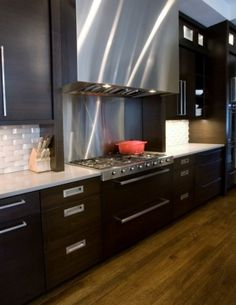 like range, drawers under range, different types of pulls, like industrial look of stainless and dark wood.