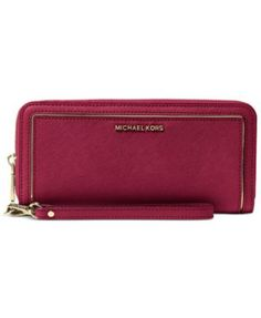 Luxuriously crafted in fine Saffiano leather with polished logo lettering, this Michael Michael Kors wallet is an absolute essential for staying stylishly and effortlessly organized on the go. The gen