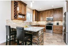 Stone back splash and stone island skirt makes this kitchen a warm amd inviting place. Country Builders, Home Builders, Stone Island, Country Kitchen, Backsplash, Warm, Skirt, Home Decor, Stone Island Outlet