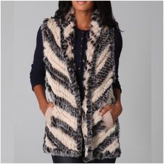 """Marc by Marc Jacobs Hayworth vest This knit wool vest features pieced fur trim. Shawl collar and open placket. Ribbed banding at welt hip pockets. Asymmetrical hem. 25"""" long, measured from shoulder. Preowned still has tags. Shell: 100% wool. Fur: Dyed rabbit fur. First picture is the one I'm selling Marc by Marc Jacobs Jackets & Coats Vests"""